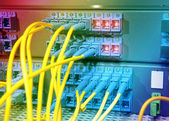 Shot of network cables and servers in a technology data center — Stock Photo