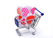 Red heart with shopping carts — Stock Photo