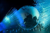 Computer data concept with earth globe against fiber optic background — Stock Photo