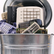 Different computer parts and phone in trash can — Stock Photo #11761116