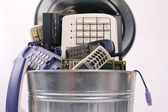 Different computer parts and phone in trash can — Stock Photo