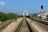 Industrial landscape with chimneys and train — Stock Photo