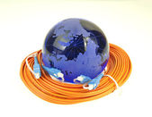 Världen kartstil teknik mot fiber optic bakgrund — Stockfoto