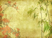 Bamboo and plum blossom on old antique paper texture — Stock Photo