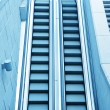 Stock Photo: Blue diminishing escalator