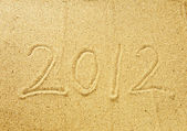 2012 new year message on the sand beach — Stock fotografie