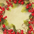 Cherry framework of christmas decorations on paper — Stock Photo