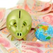 Golden pig  bank and rmb bill — Stock Photo