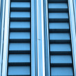 Blue diminishing escalator — Stock Photo