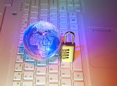 Lock and network cable with computer keyboard background — Stock Photo