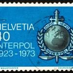 Postage stamp Switzerland 1973 Interpol Emblem — Stock Photo
