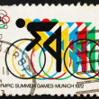 Stock Photo: Postage stamp US1972 Bicycling and Olympic Rings