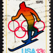 Postage stamp USA 1976 Skiing and Olympic Rings - Stock Photo