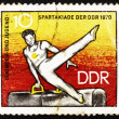 Stock Photo: Postage stamp GDR 1970 Athlete on Pommel Horse