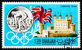 Postage stamp Manama 1968 Olympic Games London 1948, Great Brita — Stock Photo