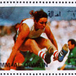 Stock Photo: Postage stamp Umm al-Quwain 1972 Long Jump, Summer Olympics, Mun