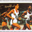 Stock Photo: Postage stamp Umm al-Quwain 1972 Sprint, Summer Olympics, Munich
