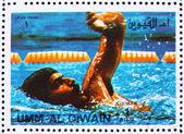 Porto stämpel um al-quwain 1972 mark spitz, vinnare av olymp — Stockfoto