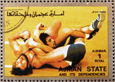 Postage stamp Ajman 1973 Wrestling, Olympic sports — Stock Photo
