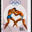 Stock Photo: Postage stamp Romani1968 Wrestling, Olympic sports, Mexico 68