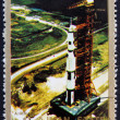 Постер, плакат: Postage stamp Ajman 1973 Roll out of Saturn 5 on launch pad