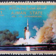Postage stamp Ajman 1973 Saturn V Rocket Launching — Stock Photo #11431918
