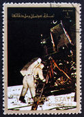 Postage stamp Ajman 1973 Aldrin Stepping out of the Eagle — Stock Photo