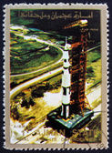 Postage stamp Ajman 1973 Roll out of Saturn 5 on launch pad — Stock Photo