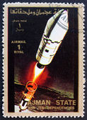 Postage stamp Ajman 1973 Rocket in Space — Stock Photo