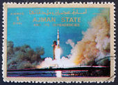 Postage stamp Ajman 1973 Saturn V Rocket Launching — Stock Photo