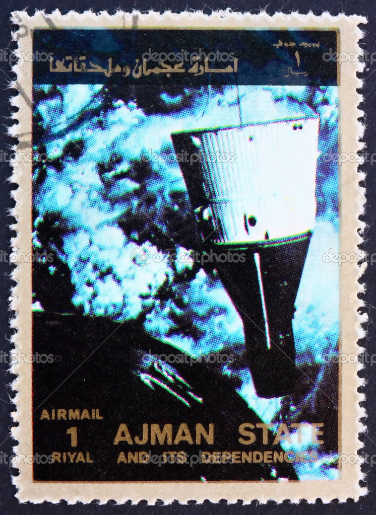 AJMAN - CIRCA 1973: a stamp printed in the Ajman shows Rendezvous of Gemini 6 and 7, Space Exploration Program, circa 1973  Stock Photo #11431977
