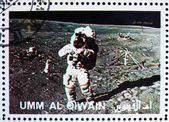 Postage stamp Umm al-Quwain 1972 Astronaut walks on the Moon — Stock Photo