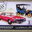 Royalty-Free Stock Photo: Postage stamp Ajman 1972 Chevrolet, Cars Then and Now