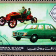 Royalty-Free Stock Photo: Postage stamp Ajman 1972 Renault, Cars Then and Now
