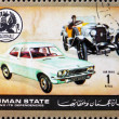 Royalty-Free Stock Photo: Postage stamp Ajman 1972 Vauxhall, Cars Then and Now