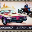 Royalty-Free Stock Photo: Postage stamp Ajman 1972 Ford, Cars Then and Now