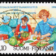 图库照片: Postage stamp Finland 1991 Home Economics Education