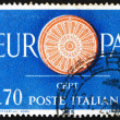 Stock Photo: Postage stamp Italy 1960 19-Spoke wheel