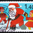 Stock Photo: Postage stamp Finland 1987 SantClaus and Youths