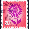 Foto Stock: Postage stamp Germany 1964 Symbolic Daisy