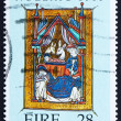 图库照片: Postage stamp Ireland 1989 Flight into Egypt, Christmas