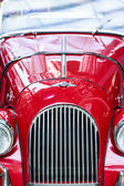 A close up view of the front of a cherry red 1963 Morgan +4 vintage automobile — Stock fotografie