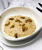 Risotto with truffle over white dish — Stock Photo