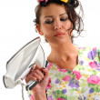 The girl with an iron — Stock Photo
