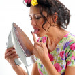 The girl in hair curlers with an iron — Stock Photo #11131522