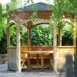 Wooden summerhouse is in park - Stock Photo