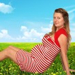 The pregnant woman in a garden — Stock Photo