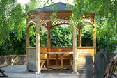 Wooden summerhouse is in park — Stock Photo