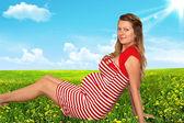 The pregnant woman in a garden — Stock Photo