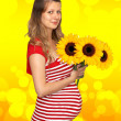 The pregnant woman and sunflower — Stock Photo